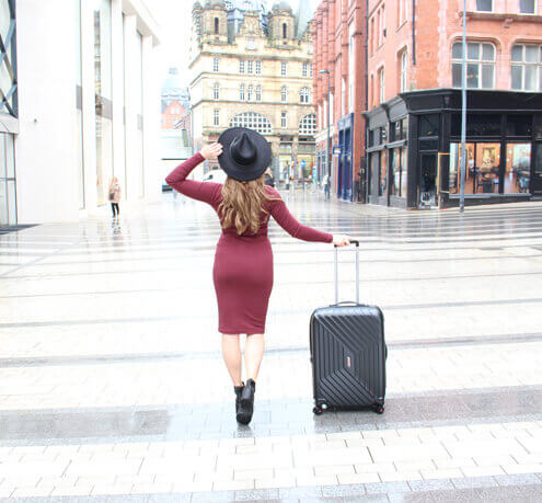 Sylvie travelling the world with her suitcase