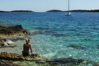 girl-sunbathing-in-hvar-croatia