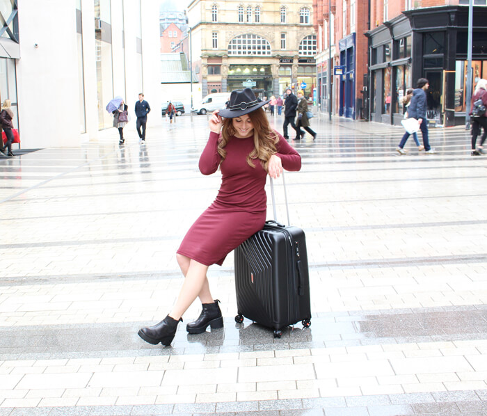 uk travel blogger leeds on suitcase